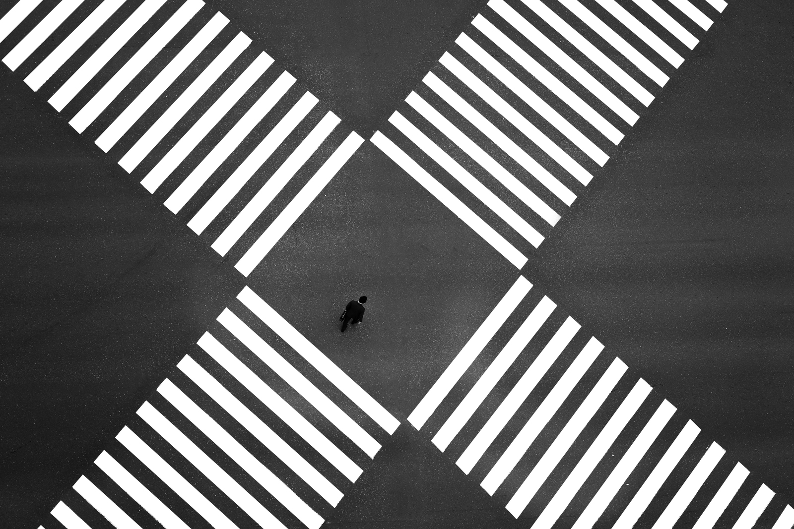 Aerial view of people crossing a big intersection in Ginza, Tokyo, Japan